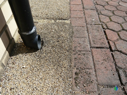 Downpipe-discharging-directly-onto-permeable-pavement-at-stamford